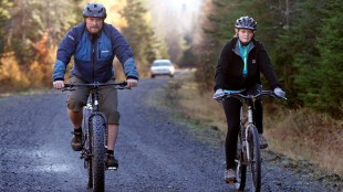 Nurse Kaci Hickox ignores the quarantine imposed by Maine to ride bikes wither her boyfriend Ted Wilbur. Source Robert F. Bukaty - AP